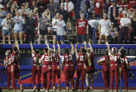 Oklahoma fans stand as players gesture to them during the fifth inning of an NCAA Women's College World Series softball game against UCLA, Saturday, June 5, 2021, in Oklahoma City. (AP Photo/Alonzo Adams)