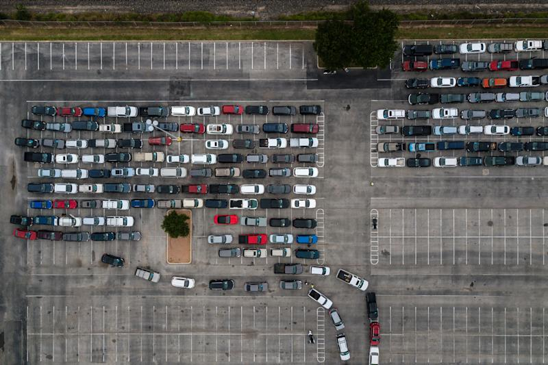 Cars wait in line at a food bank in San Antonio, Texas, May 15, 2020. (Tamir Kalifa/The New York Times)