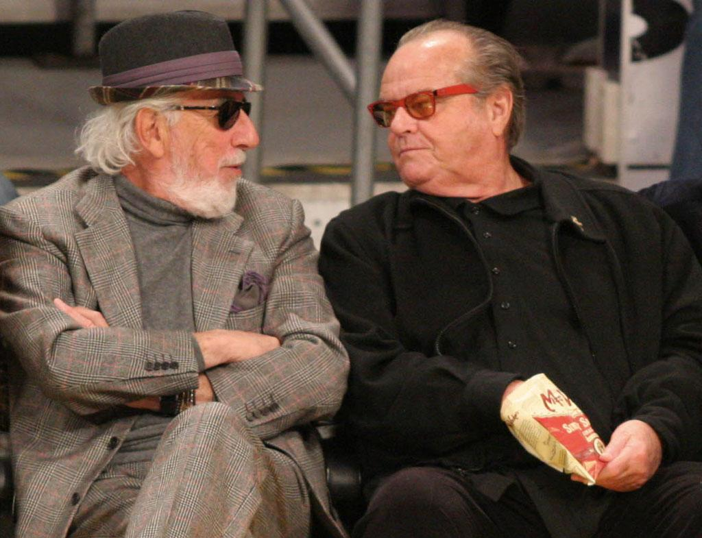 """Sandler's former """"Anger Management"""" co-star Jack Nicholson held court with his regular Lakers buddy, record producer Lou Adler. Those are some snazzy red specs Jack! <a href=""""http://www.splashnewsonline.com"""" target=""""new"""">Splash News</a> - January 31, 2011"""