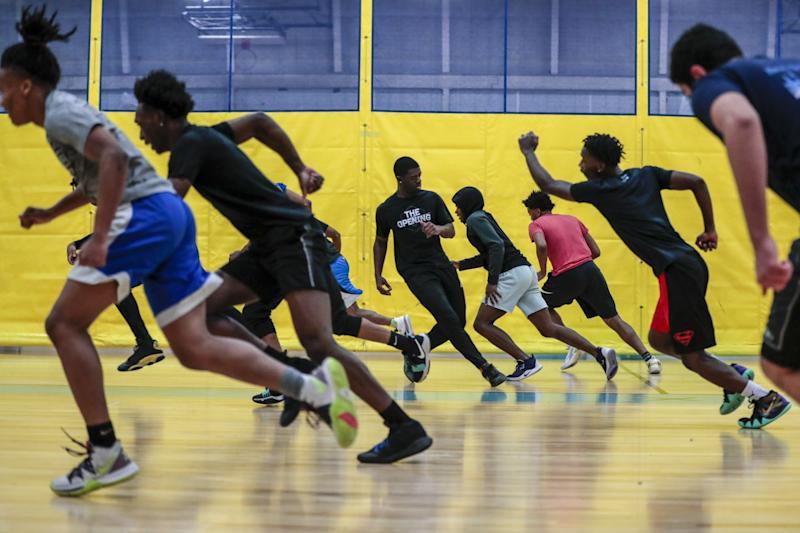 Flint basketball players run sprints in practice a day after losing Bendle.