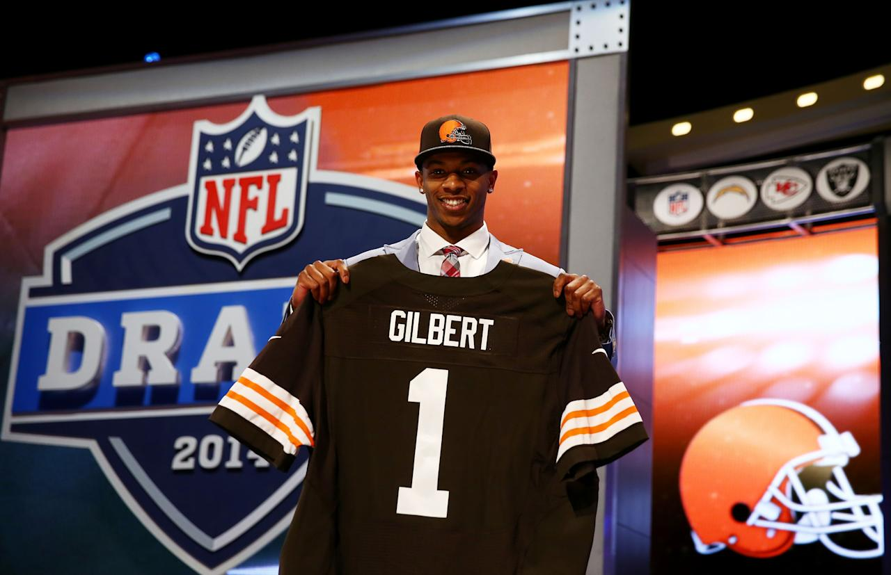 NEW YORK, NY - MAY 08: Justin Gilbert of the Oklahoma State Cowboys poses with a jersey after he was picked #8 overall by the Cleveland Browns during the first round of the 2014 NFL Draft at Radio City Music Hall on May 8, 2014 in New York City. (Photo by Elsa/Getty Images)