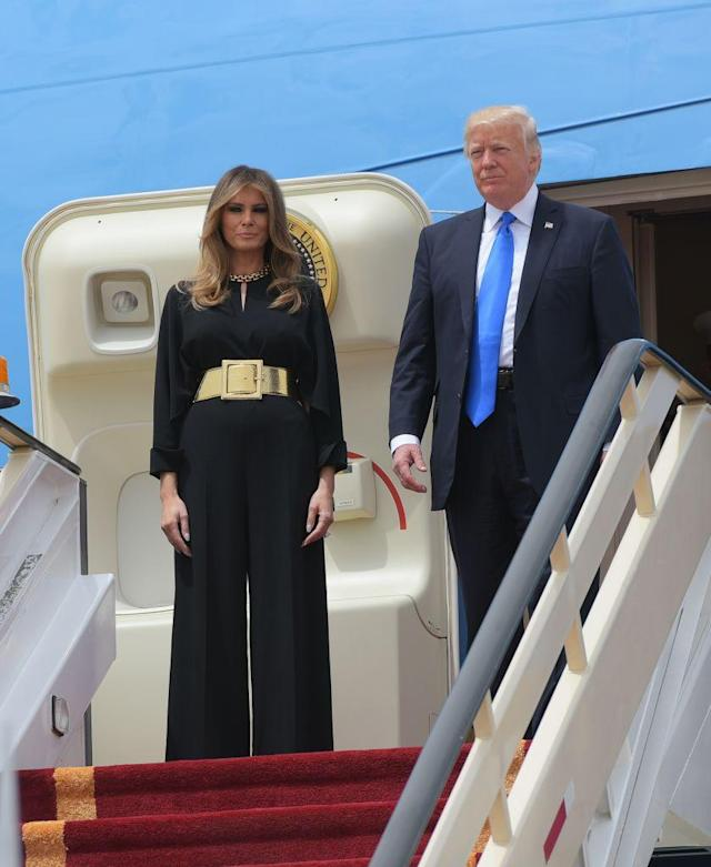 """<p>On the first stop of their tour, the President and First Lady landed in Saudi Arabia. She wore a Stella McCartney jumpsuit tailored with a gold high-waist belt by Ralph Lauren. The outfit did not include a headscarf, which caused a stir <a href=""""http://www.townandcountrymag.com/society/politics/a9900221/melania-trump-saudi-arabia/"""" rel=""""nofollow noopener"""" target=""""_blank"""" data-ylk=""""slk:due to the President's previous comments"""" class=""""link rapid-noclick-resp"""">due to the President's previous comments</a>. </p>"""