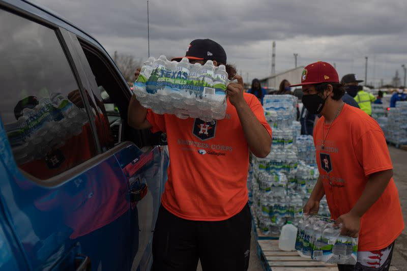Volunteers give water to residents affectred by unprecedented winter storm in Houston, Texas