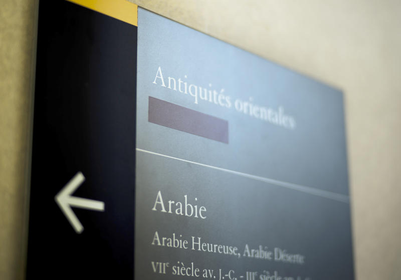 A taped over sign is pictured at the Louvre Museum in Paris, France, Wednesday, July 17, 2019. France's Louvre museum has taped over the Sackler name as donors to a wing of the building after protests against the family blamed for the opioid crisis in the United States. (AP Photo/Kamil Zihnioglu)