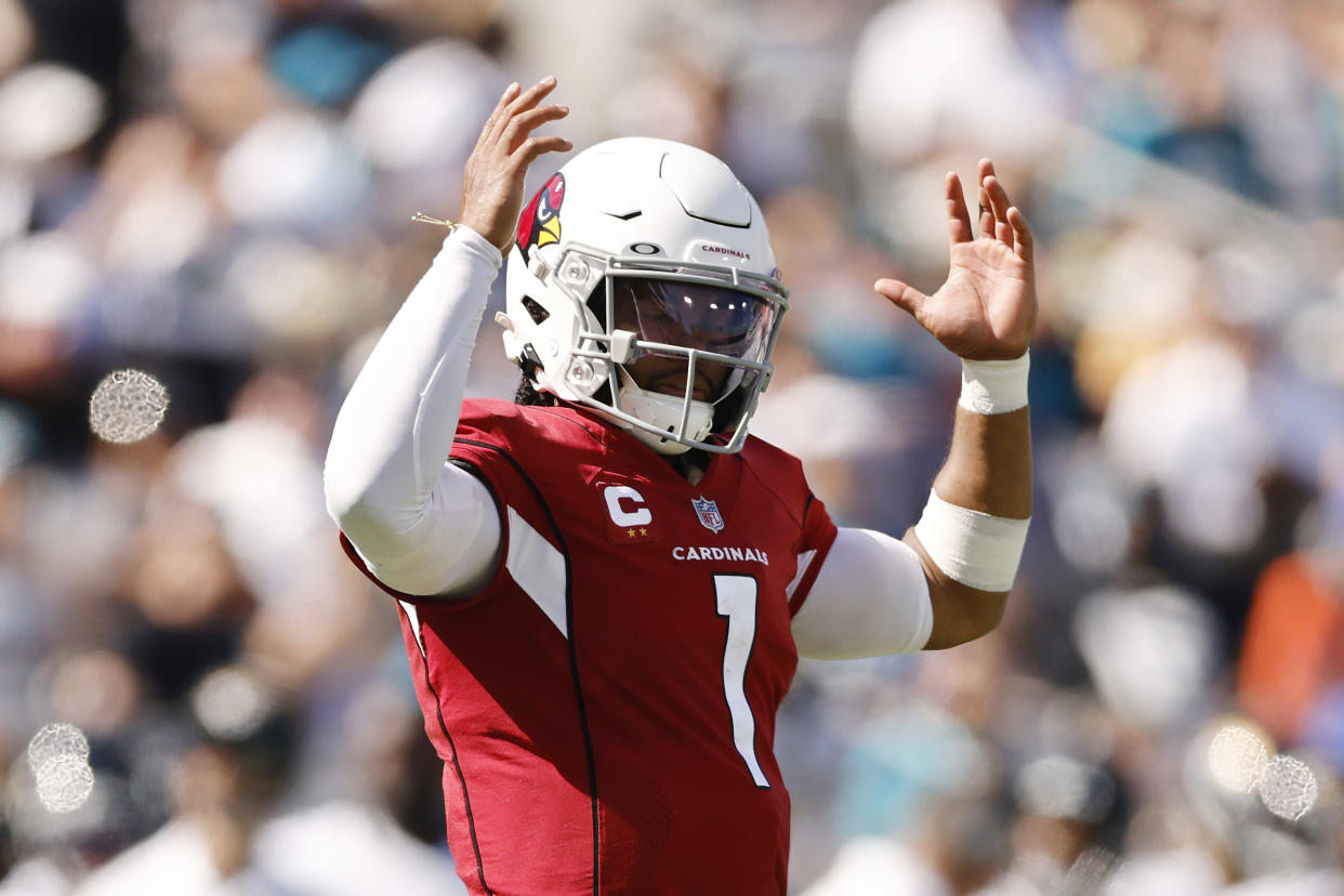 JACKSONVILLE, FLORIDA - SEPTEMBER 26: Kyler Murray #1 of the Arizona Cardinals celebrates a rushing touchdown by James Conner #6 (not pictured) against the Jacksonville Jaguars during the fourth quarter at TIAA Bank Field on September 26, 2021 in Jacksonville, Florida. (Photo by Michael Reaves/Getty Images)