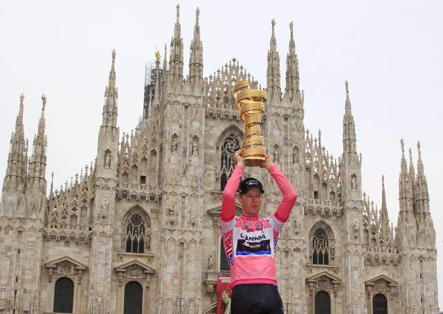 Canadian Garmin team cyclist Ryder Hesjedal celebrates with his trophy after winning the Tour of Italy (Giro) cycling race on May 27, 2012 in Milano. AFP PHOTO / LUK BENIESLUK BENIES/AFP/GettyImages
