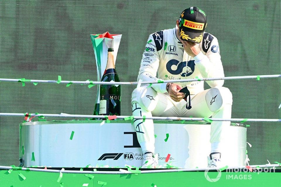 """Pierre Gasly, AlphaTauri, 1st position, sits down on the podium to contemplate his victory<span class=""""copyright"""">Mark Sutton / Motorsport Images</span>"""