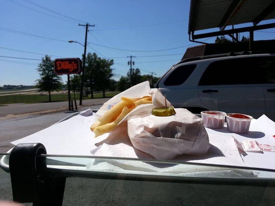 <p>Pickle lovers will love Dilly's Drive-In Restaurant, which has two locations in Northeast Ohio (one in Akron and another in Peninsula). This drive-in's signature menu item is the Double Dilly Burger, which comes with two sauces and plenty of pickles. There's even one skewered on top of the wrapper.</p>