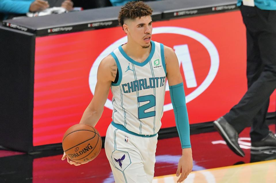 LaMelo Ball #2 of the Charlotte Hornets looks for a pass during the first quarter against the Cleveland Cavaliers at Rocket Mortgage Fieldhouse on December 23, 2020 in Cleveland, Ohio. NOTE TO USER: User expressly acknowledges and agrees that, by downloading and/or using this photograph, user is consenting to the terms and conditions of the Getty Images License Agreement.