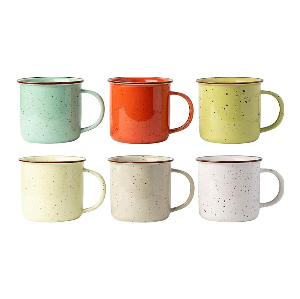 "These affordable ceramic mugs are a cute idea for anyone who recently moved and ended up selling half of their belongings on Craigslist for convenience's sake. $39, Amazon. <a href=""https://www.amazon.com/Ceramic-Speckled-Campfire-Mug-Multicolored/dp/B07Z6HQ58C/ref=asc_df_B07Z6HQ58C/"" rel=""nofollow noopener"" target=""_blank"" data-ylk=""slk:Get it now!"" class=""link rapid-noclick-resp"">Get it now!</a>"