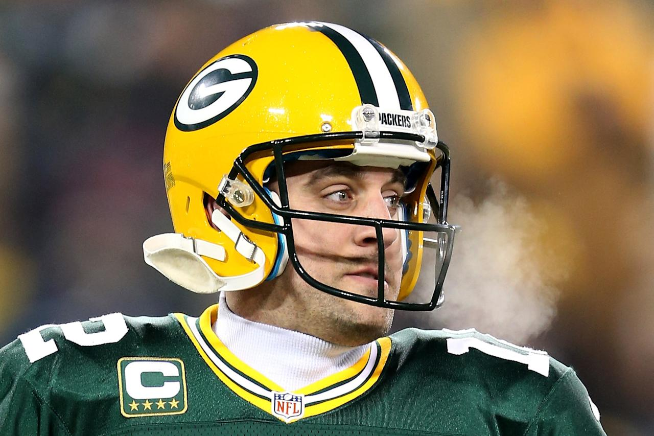 GREEN BAY, WI - JANUARY 05:  Quarterback Aaron Rodgers #12 of the Green Bay Packers on the field during pregame warm ups before taking on the Minnesota Vikings in the NFC Wild Card Playoff game at Lambeau Field on January 5, 2013 in Green Bay, Wisconsin.  (Photo by Andy Lyons/Getty Images)