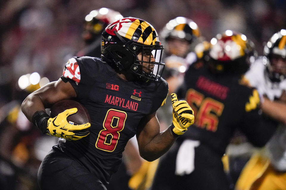 Maryland running back Tayon Fleet-Davis runs with the ball against Iowa during the first half of an NCAA college football game, Friday, Oct. 1, 2021, in College Park, Md. (AP Photo/Julio Cortez)