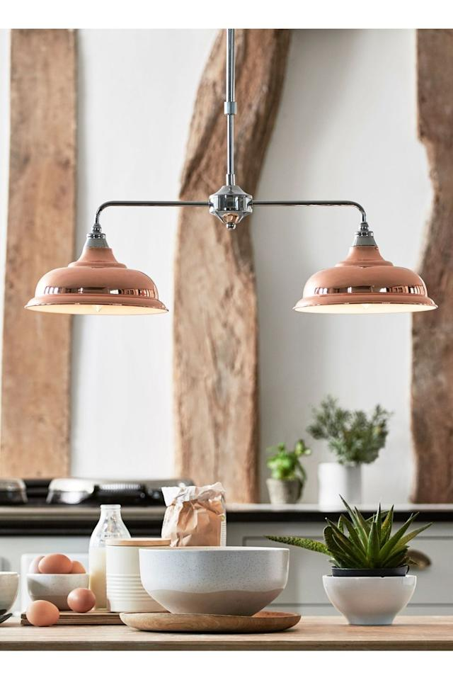 """<p>Statement lighting, such as this brass style, adds sophistication to your kitchen scheme. When it comes to lighting, keep things understated yet also grown-up. As you meal prep, cook, talk with friends over coffee or help children with homework, you'll need somewhere that feels bright and airy. To give your room that added punch of style, choose fixtures that will stand out on your Instagram feed — and watch those likes roll in. </p><p>The experts also weigh in on the importance of good lighting: 'Hanging pendant lights above an island is a popular trend that is set to continue and is a great way to create a statement in your kitchen,' Marketa Rypacek, Managing Director at <a href=""""https://www.industville.co.uk/"""" target=""""_blank"""">Industville Ltd</a> explains.</p><p>'Industrial-style pendant lights are ideal for this as they suit any era and style of home, providing a modern-rustic update. Not only are pendant lights attractive, they also provide functionality for tasks such as reading recipes and food preparation.'</p><p><strong>Pictured</strong>: <a href=""""https://www.next.co.uk/g238109s2#607915"""" target=""""_blank"""">Linear Pendant, £60, Next</a></p><p><a class=""""body-btn-link"""" href=""""https://www.next.co.uk/g238109s2#607915"""" target=""""_blank"""">BUY NOW</a></p>"""