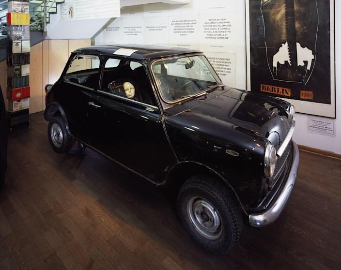 <p>One way of smuggling a passenger across was in a secret compartment in the car. The included an outsize fake fuel tank, and this BMC Mini with a concealed space for a small person inside the passenger seat.</p>