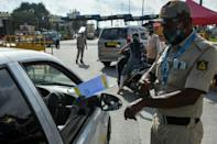 Police stop people travelling to Bangalore and direct them to undergo coronavirus screening
