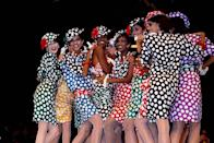 <p>French design house Emanuel Ungaro shows its spring 1985 ready-to-wear collection in Paris. The models are wearing polka-dot dresses with matching hats.</p>