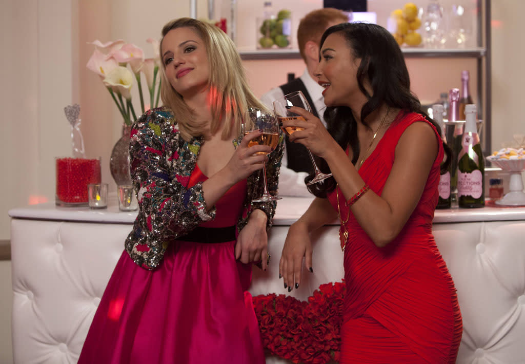 "Santana (Naya Rivera) and Quinn (Dianna Agron) reunite in Lima for Will and Emma's wedding in the ""I Do"" episode of ""Glee."""