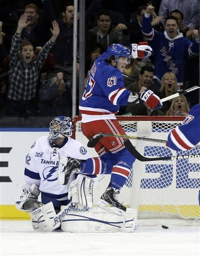 Fans, background, New York Rangers' J.T. Miller (47) and Tampa Bay Lightning's Mathieu Garon react after a goal by Carl Hagelin (62) during the first period of an NHL hockey game on Thursday, Feb. 28, 2013, in New York. (AP Photo/Frank Franklin II)