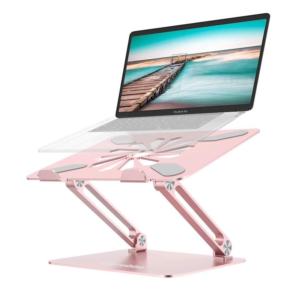"<h2>Skrebba Laptop Stand</h2><br><strong>Best For: Travel</strong><br>This stand is perfect for students, commuters, and anyone who prefers a change of scenery from time to time. <br><br><em>Shop</em> <strong><em><a href=""https://amzn.to/2PW9ksn"" rel=""nofollow noopener"" target=""_blank"" data-ylk=""slk:Skrebba"" class=""link rapid-noclick-resp"">Skrebba</a></em></strong><br><br><strong>Skrebba</strong> Laptop Stand, $, available at <a href=""https://amzn.to/2PAPHGw"" rel=""nofollow noopener"" target=""_blank"" data-ylk=""slk:Amazon"" class=""link rapid-noclick-resp"">Amazon</a>"