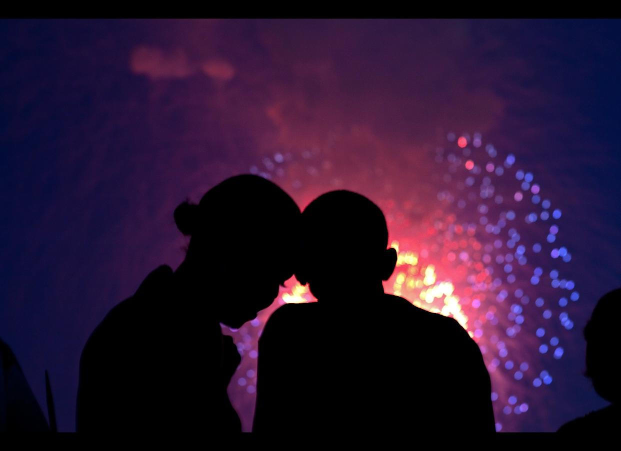 President Barack Obama and First Lady Michelle Obama watch the fireworks over the National Mall from the roof of the White House, July 4, 2010.