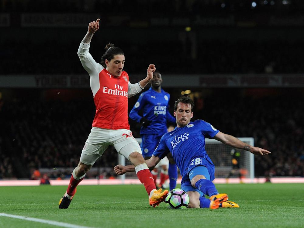 Christian Fuchs puts in a challenge on Bellerin (Getty)