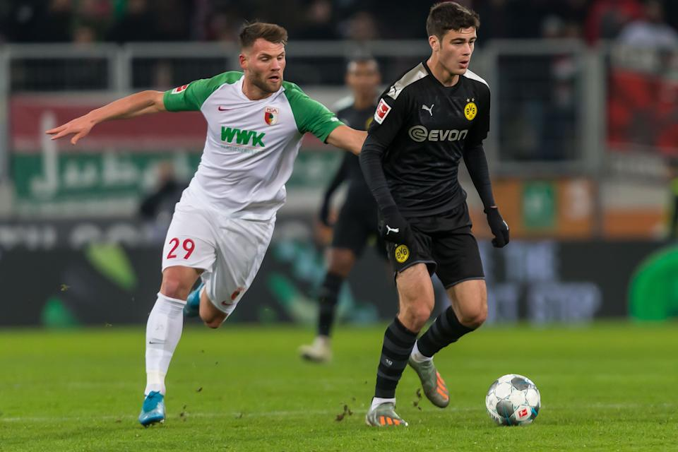 Borussia Dortmund's Giovanni Reyna (right) became the youngest American to play in the Bundesliga in Saturday's win over Augsburg. (Getty)