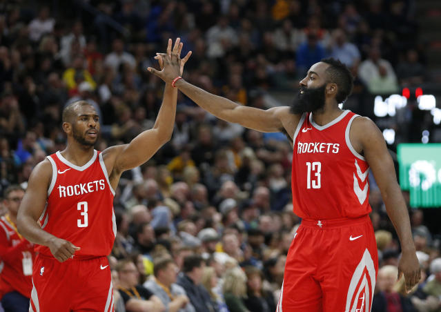 Chris Paul likes to high-five the Harden family. (AP)
