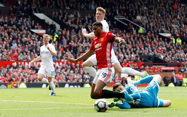 Marcus Rashford goes down to win a contentious penalty - PA