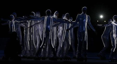 Performers take part during the opening ceremony of the 2014 Sochi Winter Olympics, February 7, 2014. REUTERS/Jim Young