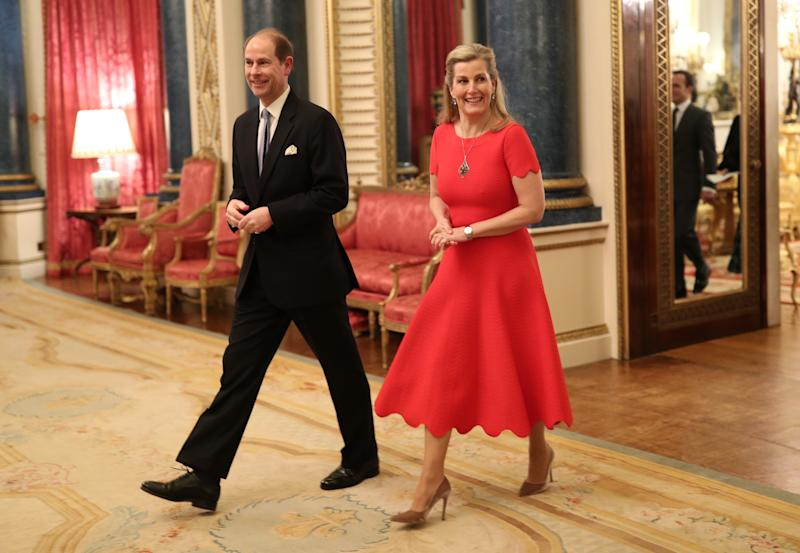 The Countess of Wessex also wore a red midi dress to the evening reception. [Photo: PA]