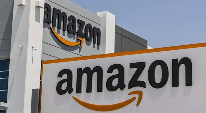 An image of an Amazon logo on a building representing AMZN stock price predictions.