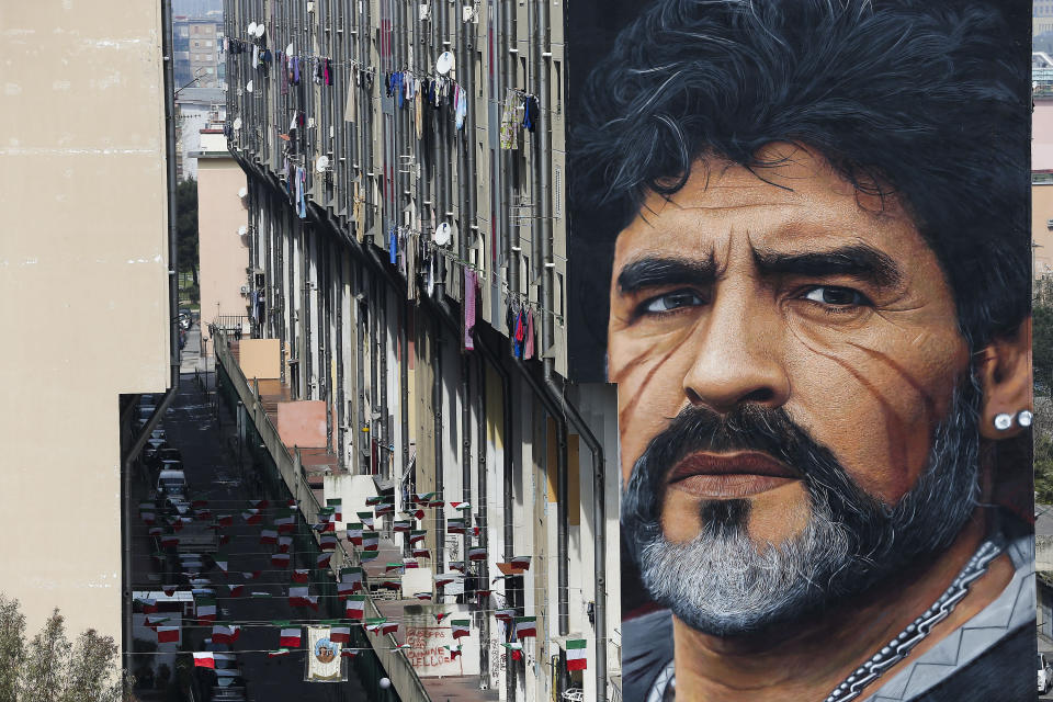 A mural depicting Diego Maradona, by street artist Jorit, is painted on a building in Naples, Italy, March 24, 2017. Diego Maradona has died. The Argentine soccer great was among the best players ever and who led his country to the 1986 World Cup title before later struggling with cocaine use and obesity. He was 60. (Marco Cantile/LaPresse via AP)