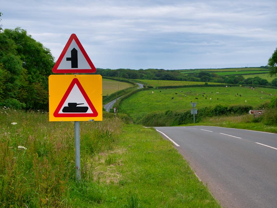 An unusual road sign near the Castlemartin Training Area military firing ranges in Pembrokeshire, Wales