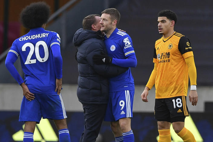 Leicester's manager Brendan Rodgers embraces Leicester's Jamie Vardy at the end of the English Premier League match between Wolves and Leicester City at the Molineux Stadium in Wolverhampton, England Sunday, Feb. 7, 2021. (Justin Tallis/Pool via AP)
