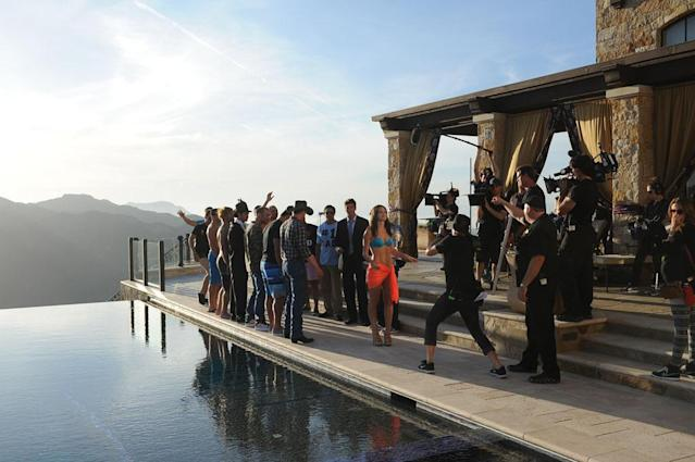 """Episode 902"" - The next day 14 men join Desiree at a swank Malibu mansion to star in a rap music video appropriately titled ""Right Reasons"" with superstar rapper Soulja Boy. He carefully selects his rapping protégés to each play the part of an infamous man from past seasons. There's Wes from Jillian Harris' season, Justin and Kasey from Ali's season, and one bachelor even reprises Jason Mesnick's legendary tearful collapse. Desiree gets into the act, rapping about her journey to find the perfect man. However at the after party the competition heats up, with Ben interrupting Mikey's alone time with the Bachelorette, sparking the first confrontation of the season. Meanwhile, Brandon opens up about his tragic broken childhood. Will displaying his deep vulnerability earn him the group date rose or will it be a turn-off? - on ""The Bachelorette."""