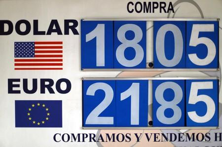 FILE PHOTO: A board displaying exchange rates for Mexican peso and U.S. dollar is pictured at a foreign exchange house in Mexico City