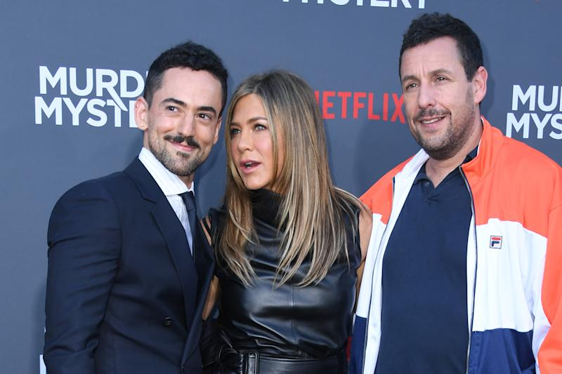 "(FromL) Mexican actor Luis Gerardo Mendez, US actress Jennifer Aniston and US actor Adam Sandler arrive to attend the Los Angeles premiere screening of the Netflix film ""Murder Mystery"" at the Regency Village Theatre in Los Angeles on June 10, 2019. (Photo by VALERIE MACON / AFP) (Photo credit should read VALERIE MACON/AFP/Getty Images)"