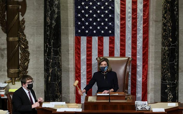 Nancy Pelosi presides over the vote to impeach President Donald Trump for a second time - Jonathan Ernst/Reuters