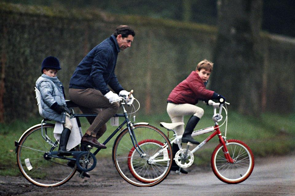 Prince Charles rides his bike with Prince William and Prince Harry.