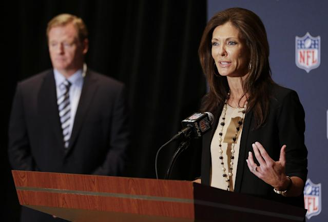 ADVANCE FOR WEEKEND EDITIONS, JUNE 28-29 - FILE - In this March 24, 2014 file photo, NFL Foundation Chair Charlotte Jones Anderson, right, speaks during a news conference to support the growth of youth football as NFL Commissioner Roger Goodell, left, listens at the NFL annual meeting in Orlando, Fla. The inherent dangers of such a physical sport certainly contribute to the decrease in players in leagues registered with USA Football, the governing body in this country. Heads Up Football, which was developed by USA Football in 2012 and launched nationwide last year teaches proper techniques that keep the head and neck out of tackling, as well as about nutrition, hydration, equipment fitting, concussion awareness and treatment. (AP Photo/John Raoux, File)