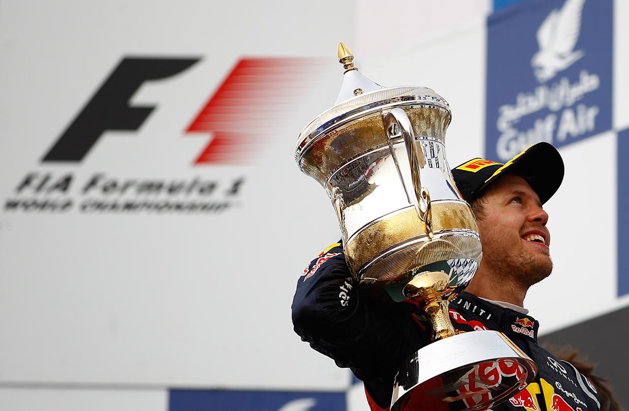 SAKHIR, BAHRAIN - APRIL 22:  Sebastian Vettel of Germany and Red Bull Racing after winning the Formula One Grand Prix of Bahrain at Bahrain International Circuit on April 22, 2012 in Sakhir, Bahrain.  (Photo by Vladimir Rys Photography via Getty Images)