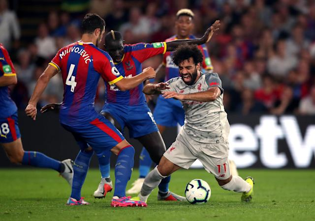 Crystal Palace's Mamadou Sakho brings down Liverpool's Mohamed Salah in the area to concede the penalty