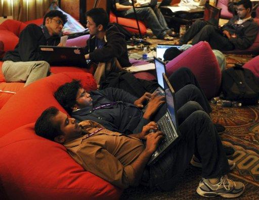 This file photo shows Indian IT professionals working on their laptops during an 'Open Hack Day' programme organised by Yahoo!, in Bangalore, in 2010. Yahoo! has set out to reclaim the Internet search crown from Google with the release of software that transforms the way users explore the Web using Apple's coveted gadgets