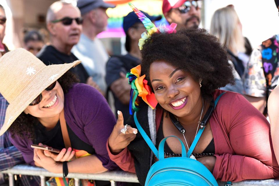 people smiling for the camera during Pride festival