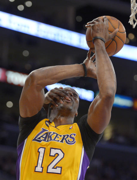 Los Angeles Lakers center Dwight Howard is slapped in the face by Portland Trail Blazers center J.J. Hickson during the first half of their NBA basketball game, Friday, Feb. 22, 2013, in Los Angeles. (AP Photo/Mark J. Terrill)