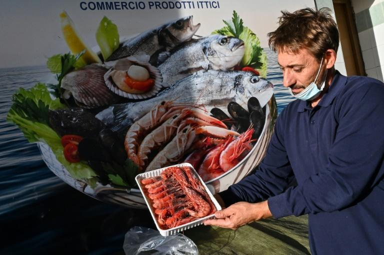 Massimo Culicchia, 50, sells the giant red shrimp caught by Mazara's fishing boats