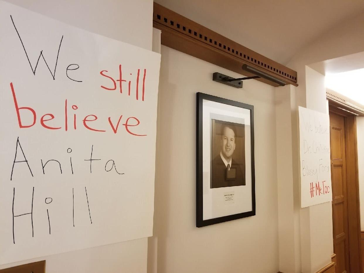 Another sign on Yale's campus, next to a photo of Kavanaugh. (Photo: Courtesy Yale Law School students organizing protests)