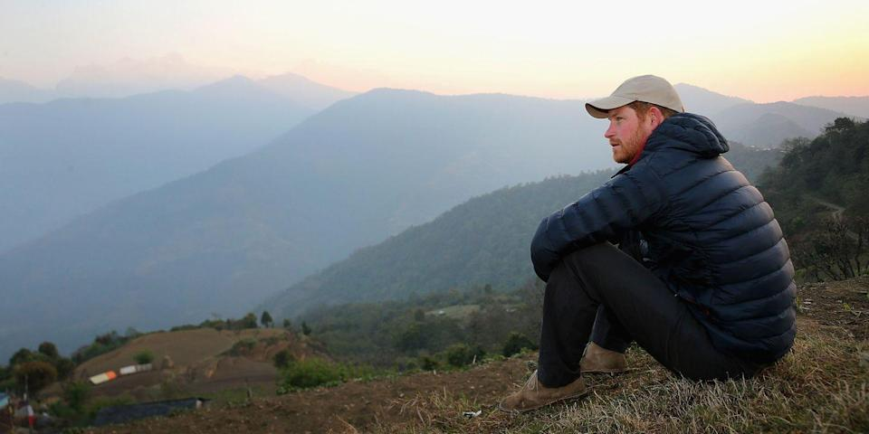 <p>Harry watches the sun set in Bardia, Nepal.</p>