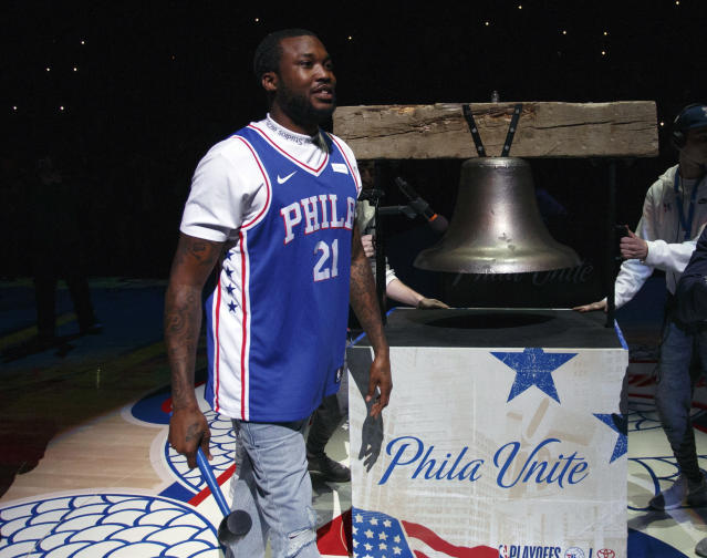 Rapper Meek Mills comes out to ring a Liberty Bell replica before the first half in Game 5 of a first-round NBA basketball playoff series between the Miami Heat and the Philadelphia 76ers, Tuesday, April 24, 2018, in Philadelphia. (AP Photo/Chris Szagola)
