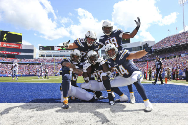 <p>Los Angeles Chargers' Melvin Gordon, center celebrates his touchdown with teammates during the first half of an NFL football game against the Buffalo Bills, Sunday, Sept. 16, 2018, in Orchard Park, N.Y. (AP Photo/Rich Barnes) </p>